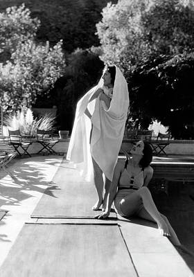 Bedouin Photograph - Two Women By A Swimming Pool by Horst P. Horst