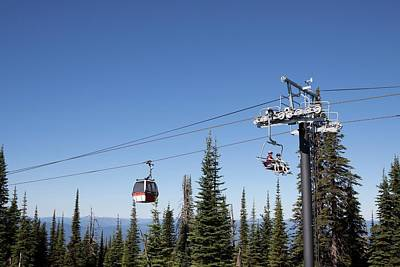 Chairlift Photograph - Two Women Ride A Chairlift To Mountain by Craig Moore