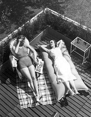 Sunbathers Photograph - Two Women Sunbathing by Underwood Archives