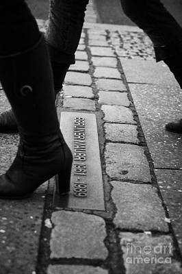 two women walking across double row of bricks across berlin to mark the position of the berlin wall berliner mauer Berlin Germany Art Print by Joe Fox