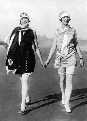 Photograph - Two Women Walking On Beach by Underwood Archives