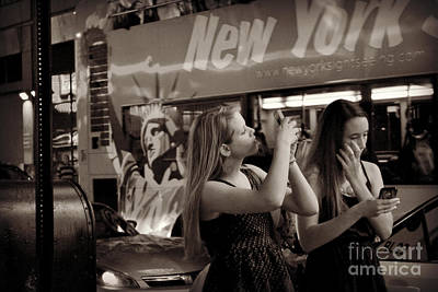 Photograph - Girls With Phones And Tourbus - Times Square by Miriam Danar