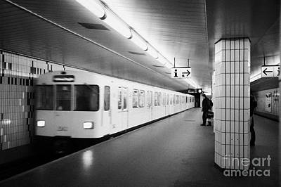 U-bahn Photograph - u-bahn train pulling in to ubahn station Berlin Germany by Joe Fox