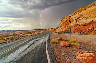 Uncertainty - Lightning Striking During A Storm In The Valley Of Fire State Park In Nevada. Print by Jamie Pham