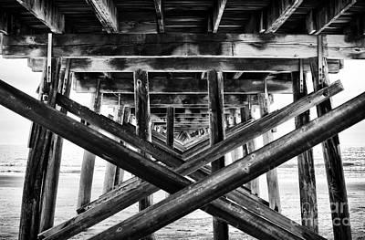 Under The Pier Art Print by John Rizzuto