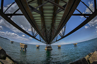 Under The Pier  Print by Michael Demagall