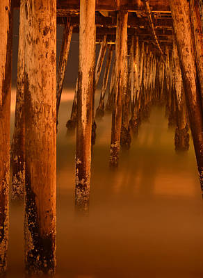 Under The Pier Art Print by Mike Schmidt