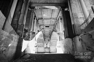 underneath the university bridge over the freezing south saskatchewan river Saskatoon Canada Art Print by Joe Fox