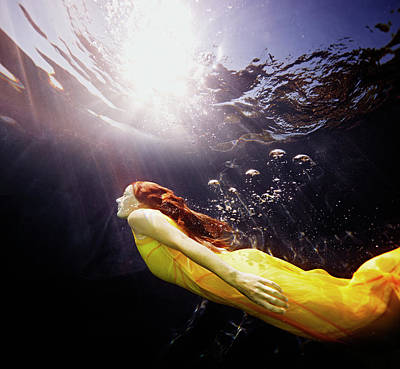 Photograph - Underwater View Of Woman Swimming To by Thomas Barwick