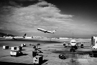 united airlines aircraft taking off taxiing and on stand at the San Francisco International Airport  Print by Joe Fox