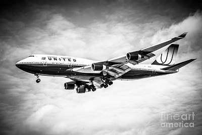 Airliners Photograph - United Airlines Boeing 747 Airplane Black And White by Paul Velgos