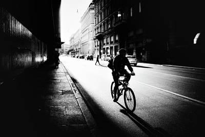 Riding Wall Art - Photograph - Urban Cyclist by Massimiliano Mancini