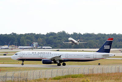 Photograph - Us Airways Takeoff by Joseph C Hinson Photography