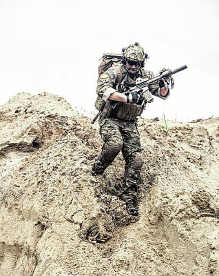 Photograph - U.s. Army Commando Moving Down A Steep by Oleg Zabielin