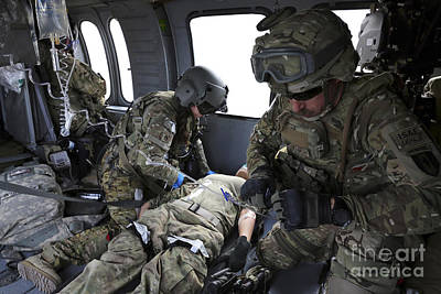 U.s. Army Flight Medics Aid A Simulated Art Print by Stocktrek Images