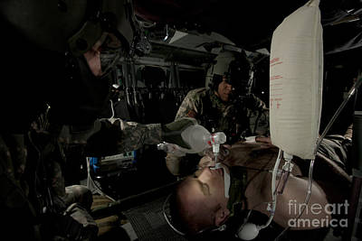 Chief Blackhawk Photograph - U.s. Army Medics Simulating Ventilation by Terry Moore