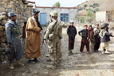 Afghanistan National Police Photograph - U.s. Army Soldier And An Afghan Uniform by Stocktrek Images
