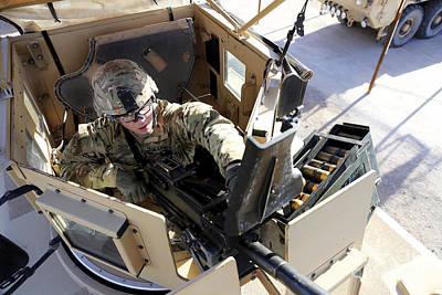 U.s. Army Soldier Checks A Mk-19 Print by Stocktrek Images