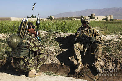 Afghan National Army Photograph - U.s. Army Soldier Takes A Break With An by Stocktrek Images