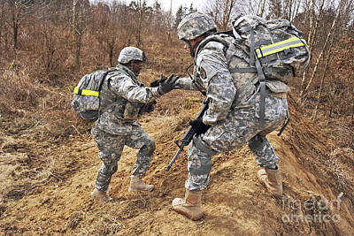 Featured Tapestry Designs - U.s. Army Soldiers Helps A Fellow by Stocktrek Images