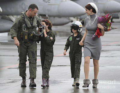 Caring Mother Photograph - U.s. Aviator Walks With His Family by Stocktrek Images