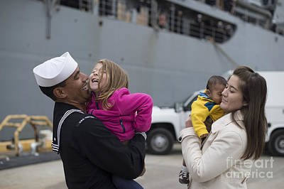 Caring Mother Photograph - U.s. Navy Sailor Greets His Family by Stocktrek Images