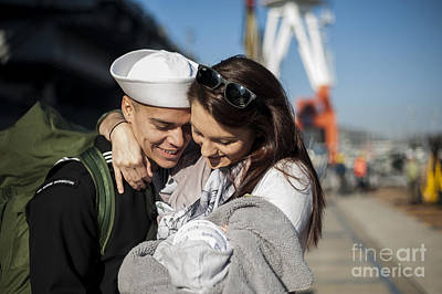 Caring Mother Photograph - U.s. Navy Sailor Hugs His Wife by Stocktrek Images