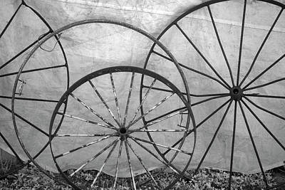 Wagon Wheels Photograph - Usa, Florida, Plant City, Old Metal by Connie Bransilver