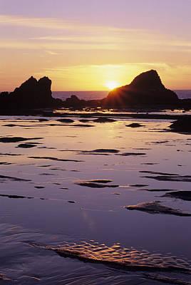 Sun Soaked Photograph - Usa, Sun Setting Over Rocks And by Greg Vaughn