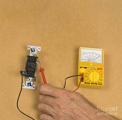 Using Electric Gauge To Test Current Art Print by Dorling Kindersley