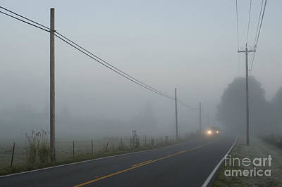 American West - Valley fog with truck lights on back road by Jim Corwin