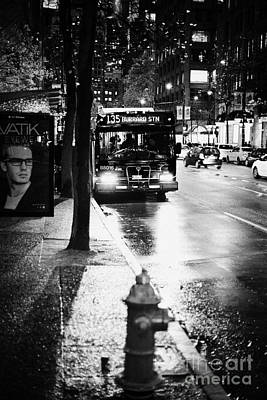 Busstop Photograph - Vancouver City Bus At Stop On Wet Street In Early Evening In Downtown City Centre Bc Canada by Joe Fox