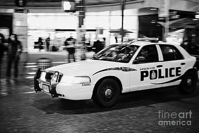 Vancouver Police Squad Patrol Car Vehicle Bc Canada Deliberate Motion Blur Print by Joe Fox
