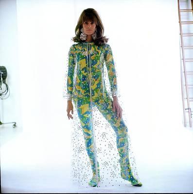 Vanessa Wall Art - Photograph - Vanessa Redgrave Wearing A Transparent Coat by Bert Stern
