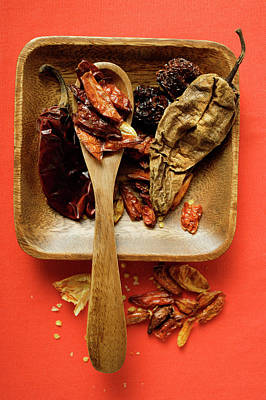 Various Dried Chili Peppers In Wooden Bowl Art Print