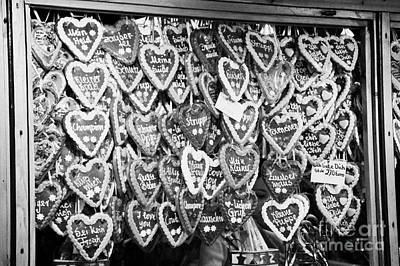 various Lebkuchen hearts hang for sale from a stall in the christmas market Berlin Germany Art Print by Joe Fox