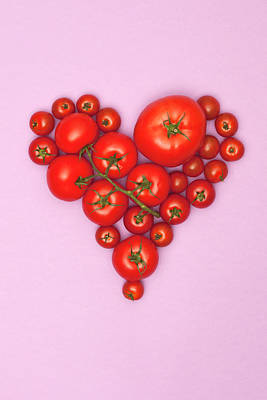 Food Photograph - Various Sizes Of Tomatoes Arranged Into by Larry Washburn