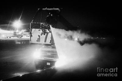 vehicle de-icing aircraft wings at night at Regina airport saskatchewan canada Art Print