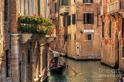 Photograph - Venice Italy Gondola Floats On A Canal Among Old Venetian Architecture by Michal Bednarek