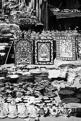 African Ceramics Photograph - Vertical Rows Of Local Speciality Ceramics For Sale To Tourists On A Stall In The Souk Market In Nabeul Tunisia by Joe Fox