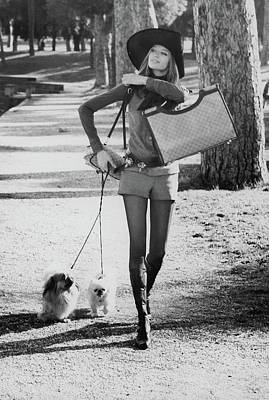 Photograph - Veruschka Holding A Gucci Bag by Henry Clarke