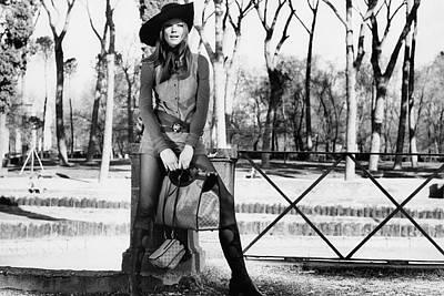 Photograph - Veruschka Holding Gucci Handbags In Rome by Henry Clarke