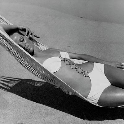 Black And White Photograph - Veruschka Von Lehndorff Lying In A Hammock by Franco Rubartelli