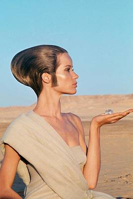 Northern Africa Photograph - Veruschka Von Lehndorff Sitting In A Desert by Franco Rubartelli