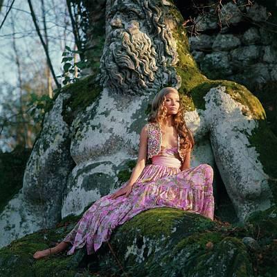 Garden Of Europe Photograph - Veruschka Von Lehndorff Sitting On A Sculpture by Franco Rubartelli