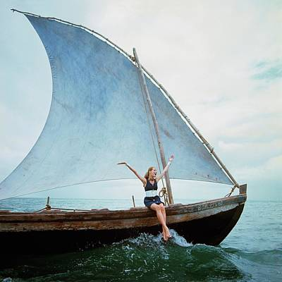 Sailboats Photograph - Veruschka Von Lehndorff Sitting On Edge by Franco Rubartelli