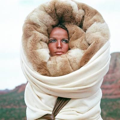Veruschka Von Lehndorff Wearing A Fur Wrap Art Print by Franco Rubartelli