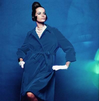 Photograph - Veruschka Wearing A Branell Trench Coat by Bert Stern