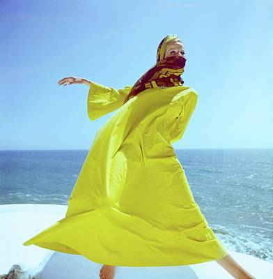 Photograph - Veruschka Wearing A Yellow Kaftan by Henry Clarke