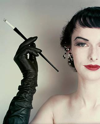 Studio Shot Photograph - Victoria Von Hagen Holding A Cigarette Holder by Erwin Blumenfeld